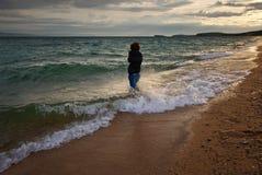 Woman on beach Stock Photos