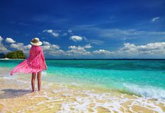 Woman at the beach. Woman in pink pareo and hat at the beach, Andaman Sea, Thailand Royalty Free Stock Photo