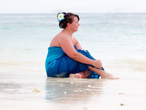 Woman on a beach royalty free stock image