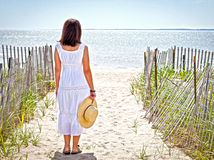 Woman at beach. Pretty woman at the beach with a straw hat Royalty Free Stock Photo
