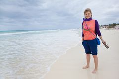 Woman on the beach. Young woman dressed casualy standing on the beach in Mexico Royalty Free Stock Photo