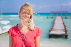 Woman on the beach. Portrait of a young woman standing on the beach and smiling Royalty Free Stock Image