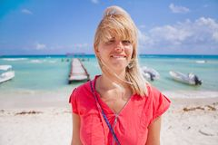 Woman on the beach. Portrait of a young woman standing on the beach and smiling Stock Photo