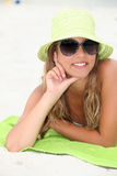 Woman at the beach. A woman relaxing at the beach Stock Photos