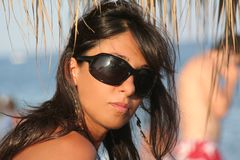 Woman in the beach. Sun and sea waves / Glances sensual between holidaymakers Royalty Free Stock Photo