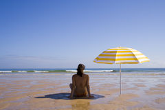 Woman at the beach Stock Photos