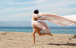 Woman on the beach. Woman running on the beach Stock Photo