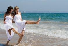 Woman on beach. Two beautiful woman best friends on beach having fun Stock Photo