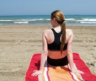 Woman at the beach. Blond girl sitting at the beach Stock Photo