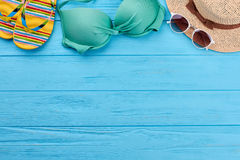 Woman beach accessories on sea background. Royalty Free Stock Images