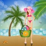 Woman with beach bag on the beach Stock Photos