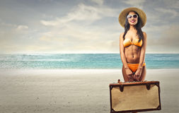 Woman on the beach with a bag stock images