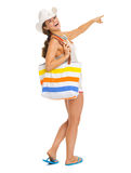 Woman with beach bag pointing on copy space Stock Photos