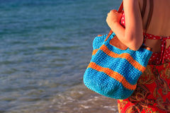 Woman with beach bag at the sea Stock Photo
