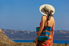 Woman with beach bag at the sea Royalty Free Stock Photos