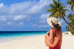 Woman with beach bag at the sea Stock Photos