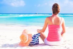 Woman with beach bag and straw hat on tropical. Remote tropical beaches and countries. travel concept Stock Image