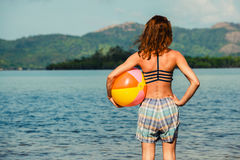 Woman with beach ball on the beach Royalty Free Stock Photos