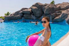 Woman with Beach Ball at Edge of Grotto Pool Royalty Free Stock Photo
