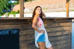 Woman at the beach bar Royalty Free Stock Image
