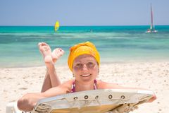 Woman on the beach bed Royalty Free Stock Image