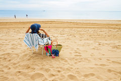 Woman in beach chair Stock Images