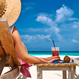 Woman at beach with chaise-lounges. Woman at beautiful beach with chaise-lounges royalty free stock photos
