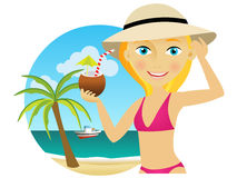 Woman on the beach with a cocktail. Beautiful young blonde woman in a hat and bikini enjoying a cocktail Royalty Free Stock Image