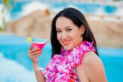 Woman on the beach with cocktail Stock Photo