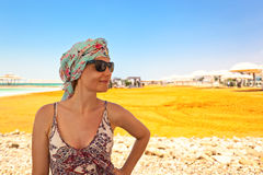 Woman on a beach of dead sea Stock Photography
