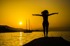 Woman on the beach doing king dancer pose Royalty Free Stock Images