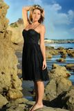 Woman on the beach in dress Royalty Free Stock Photography
