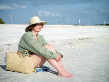 Woman on the beach enjoying the warm weather Stock Photo