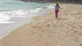 Woman on beach stock video