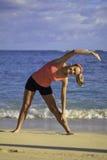 Woman at the beach exercising Stock Photos