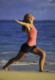 Woman at the beach exercising Royalty Free Stock Photo