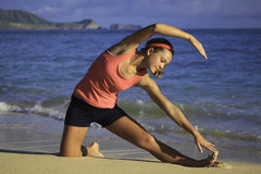 Woman at the beach exercising Royalty Free Stock Image