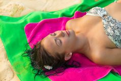 Woman on beach gets sun tan Royalty Free Stock Image