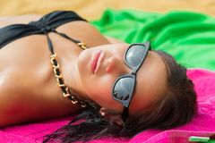 Woman on beach gets sun tan Royalty Free Stock Photos
