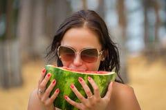 Woman on beach gets sun tan Stock Photo