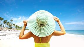 Woman on the beach. Stock Photos