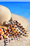 Woman beach hat, bright towel Royalty Free Stock Photo