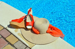 Woman beach hat,  red sandals and starfish. Stock Photo