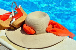 Woman beach hat,  red sandals and starfish. Royalty Free Stock Photos