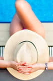 Woman with beach hat relaxing at the inside pool Royalty Free Stock Photos