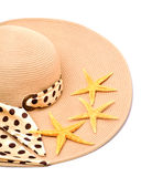 Woman beach hat and a seashell Royalty Free Stock Photos