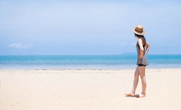Woman and beach hat on tropical beach. Woman in bikini and beach hat on tropical beach,Thailand stock photo