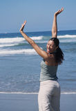 Woman on the beach having fun Royalty Free Stock Photography