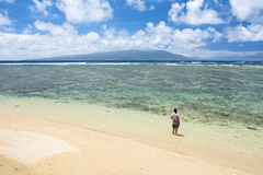 Woman on beach in Hawaii stock photos
