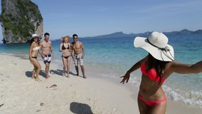 Woman On Beach Holding Cell Smart Phone Call People Group To Take Selfie Photo, Happy Smiling Young Tourists Group stock video footage